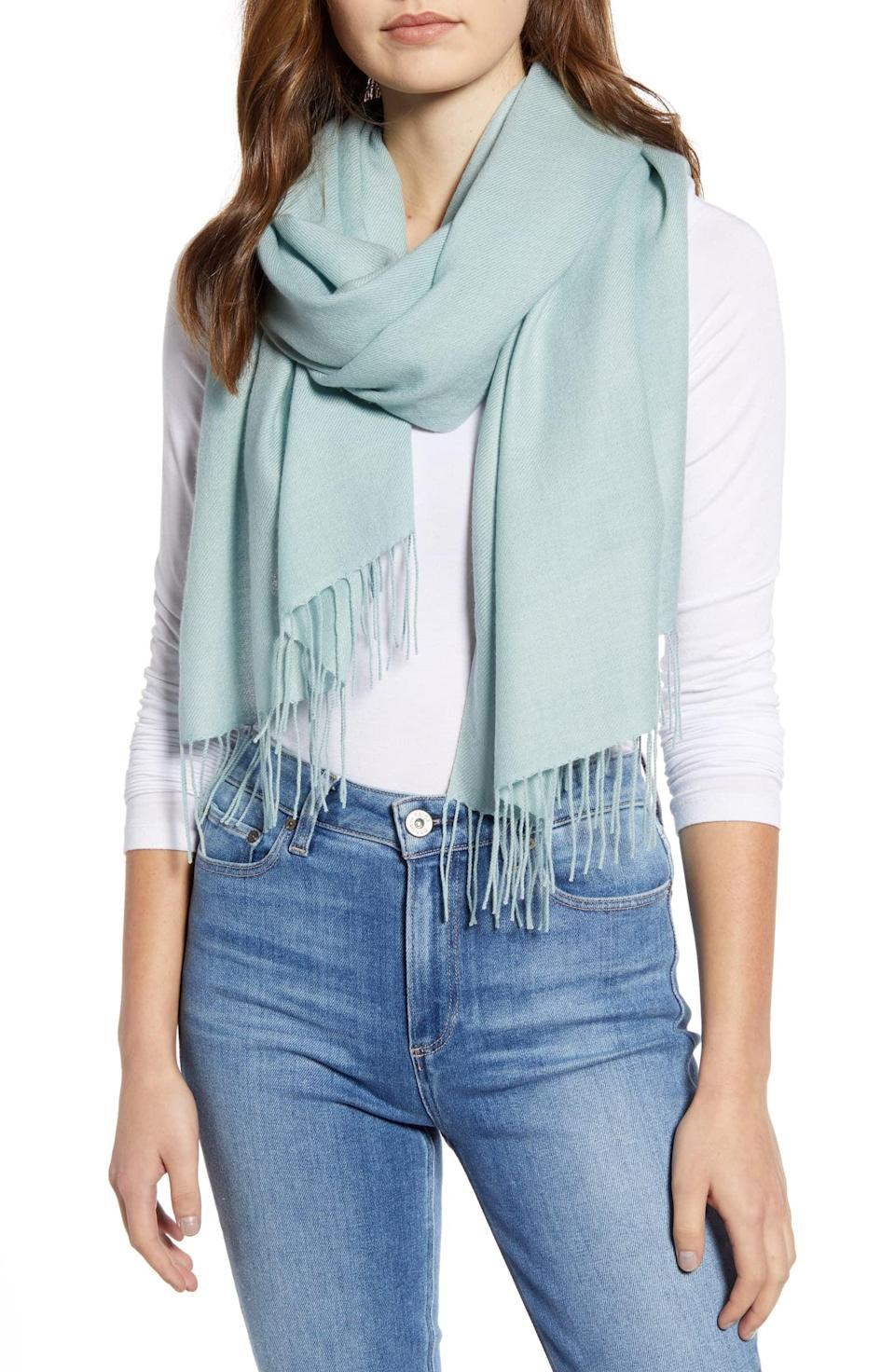 <p>This <span>Nordstrom Tissue Weight Wool &amp; Cashmere Scarf</span> ($99) will not only keep you warm on chilly airplanes, but can also act as a barrier between you and the seat. It's a win win.</p>