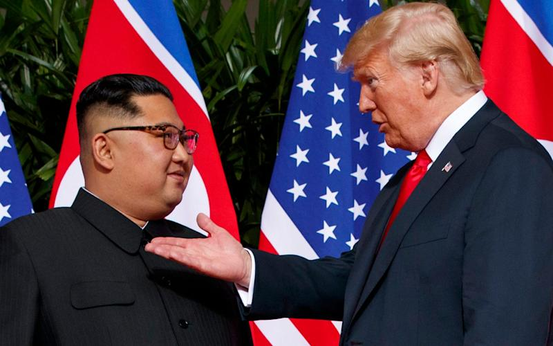 Kim Jong-un and President Trump met for the first time in Singapore last June - AP