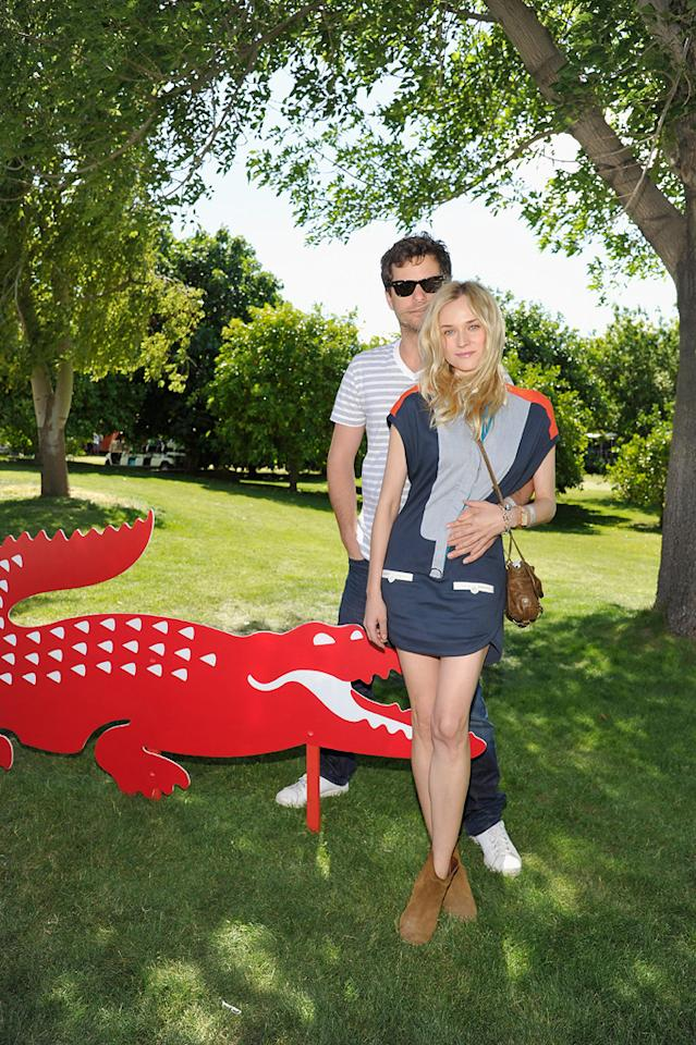 Joshua Jackson and Diane Kruger attend the Lacoste pool party during the Coachella Music Festival in Thermal, California.