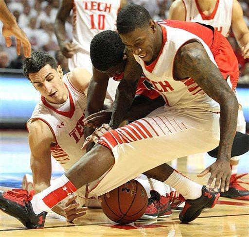 Texas Tech's Dejan Kravic, left, and Trency Jackson, right, scramble for a loose ball with Arizona's Solomon Hill, center, during an NCAA college basketball game in Lubbock, Texas, Saturday, Dec. 1, 2012. (AP Photo/Lubbock Avalanche-Journal, Zach Long)