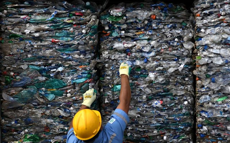 An officer shows a container full with plastic waste at Tanjung Priok port in Jakarta, Indonesia. - via REUTERS
