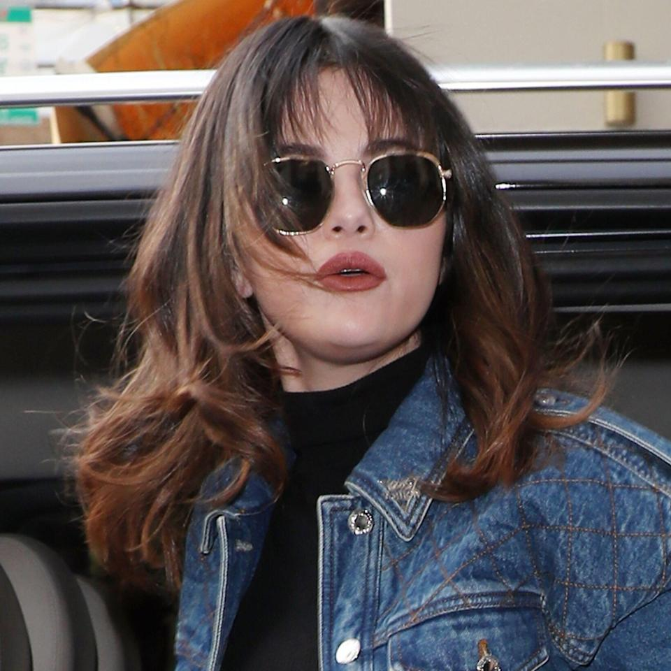 """Selena Gomez <a href=""""https://www.allure.com/story/selena-gomez-shag-haircut-bangs?mbid=synd_yahoo_rss"""" rel=""""nofollow noopener"""" target=""""_blank"""" data-ylk=""""slk:recently stepped out"""" class=""""link rapid-noclick-resp"""">recently stepped out</a> in London with her take on the 2020 shag. """"Long shags are great for girls who love movement and love longer hair,"""" says hairstylist <a href=""""https://www.instagram.com/tedgibson/?hl=en"""" rel=""""nofollow noopener"""" target=""""_blank"""" data-ylk=""""slk:Ted Gibson"""" class=""""link rapid-noclick-resp"""">Ted Gibson</a>. """"The thing that's great about the modern shag is the texture. In the '70s it was straight."""" This new version of the shag gives you more space for texture. We love the <a href=""""https://www.allure.com/story/hair-flip-trend?mbid=synd_yahoo_rss"""" rel=""""nofollow noopener"""" target=""""_blank"""" data-ylk=""""slk:flipped-up ends"""" class=""""link rapid-noclick-resp"""">flipped-up ends</a> Gomez has here, which add a fresh touch to the classic style."""