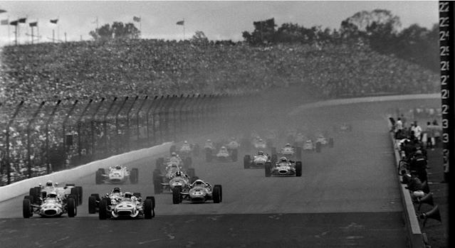 """FILE - In this May 30, 1967, file photo, Mario Andretti (1) leads the field at the start of the 51st running of the Indianapolis 500 at Indianapolis Motor Speedway in Indianapolis. The race had to be stopped for rain, and was restarted the following day. Gordon Johncock (3), far left, and A.J. Foyt (14), center, the eventual race winner, also compete. When it came to deciding the greatest rivalry, Foyt, Andretti and Bobby Unser received the most attention. 1986 winner Bobby Rahal says """"the greatest rivalry had to be A.J. Foyt against anyone else."""" (AP Photo, File)"""