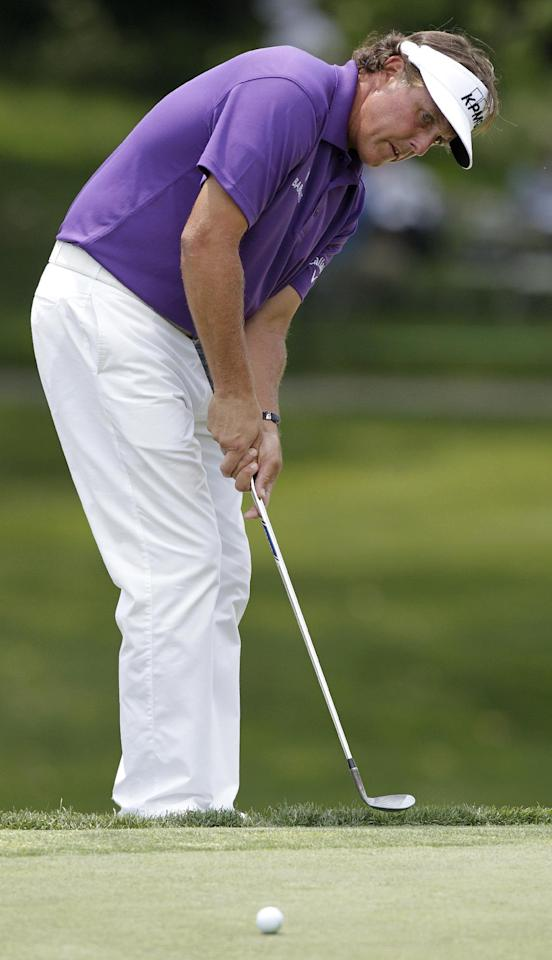 Phil Mickelson chips on the fourth hole during the first round of the Memorial golf tournament Thursday, May 31, 2012, in Dublin, Ohio. (AP Photo/Jay LaPrete)
