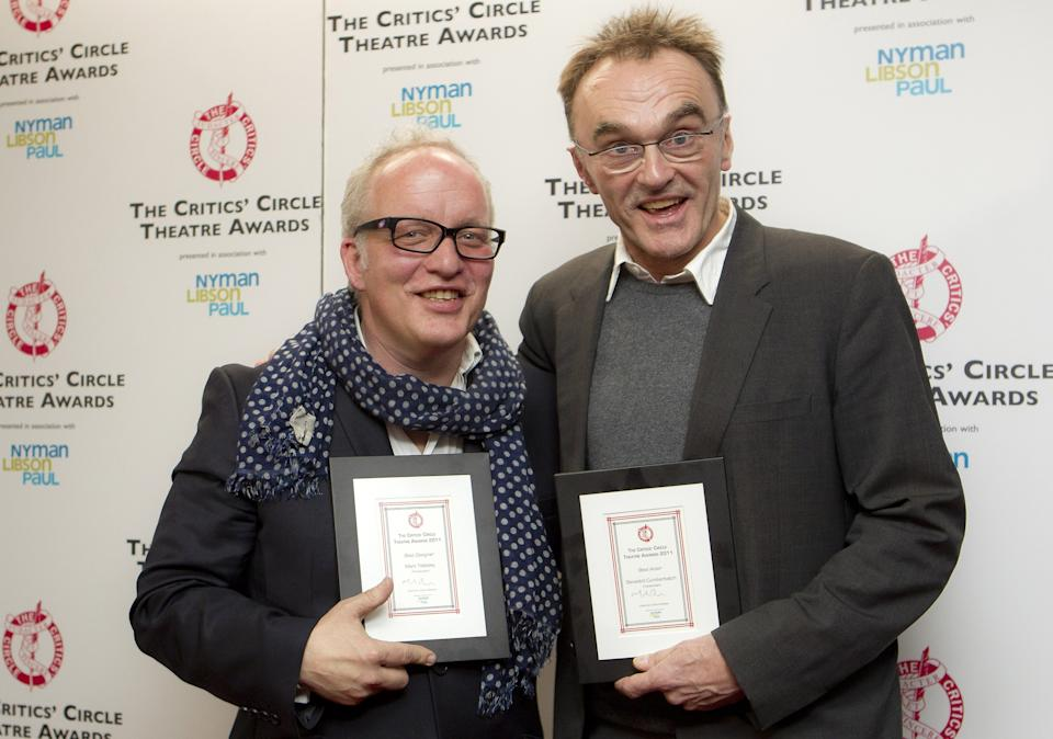 British designer Mark Tildesley, left, with the London Critics' Circle Theatre Award for Best Designer and British director Danny Boyle, who collected the Best Actor Award on behalf of Benedict Cumberbatch, after the London Critics' Circle Theatre Awards at the Prince of Wales Theatre in central London, Tuesday, Jan. 24, 2012. (AP Photo/Joel Ryan)