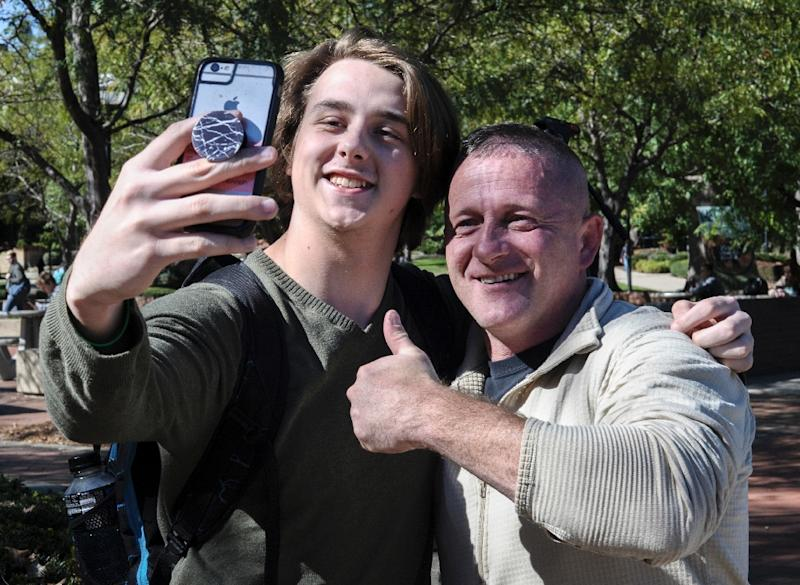 Richard Ojeda (R) a Democratic congressional candidate for a US House seat in West Virginia, poses for a photograph in Huntington with Hunter King, an 18-year-old son of a coalminer (AFP Photo/MICHAEL MATHES)