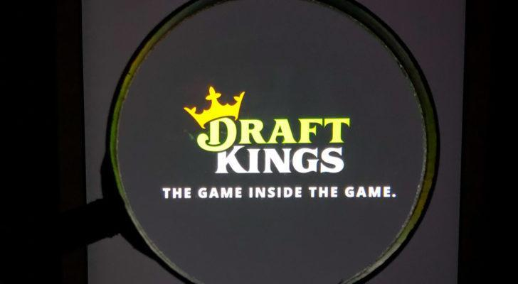 DraftKings (DKNG) logo, magnified, on its app.