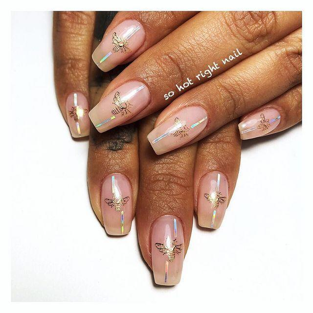 """<p>We love these Gucci inspired bees, but if you're not a designer fan, swap out the design for any other nail transfer.</p><p><a href=""""https://www.instagram.com/p/Bsz0ARuAON5/"""" rel=""""nofollow noopener"""" target=""""_blank"""" data-ylk=""""slk:See the original post on Instagram"""" class=""""link rapid-noclick-resp"""">See the original post on Instagram</a></p>"""
