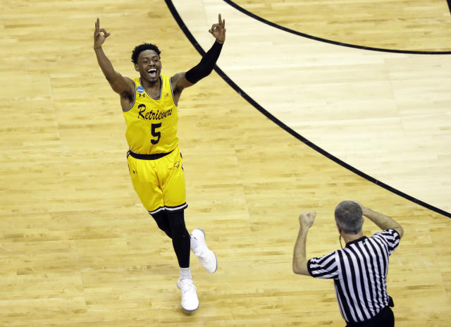 UMBC's Jourdan Grant celebrates as his Retrievers pulls away from top-ranked Virginia. (AP Photo/Chuck Burton)