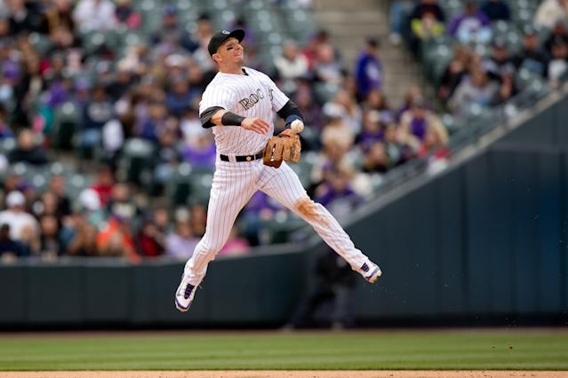 DENVER, CO - APRIL 6: Shortstop Troy Tulowitzki #2 of the Colorado Rockies makes a leaping throw to second base for an out during the eighth inning against the Arizona Diamondbacks at Coors Field on April 6, 2014 in Denver, Colorado. The Diamondbacks defeated the Rockies 5-3. (Photo by Justin Edmonds/Getty Images)