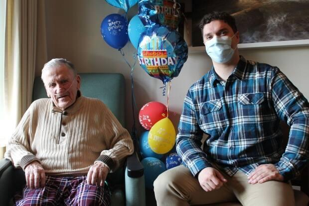 Jack Roche, left, wrote a song about his love of Vancouver with the help of music therapist Josh Denny-Keys. (Providence Health Care - image credit)