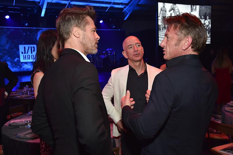 Brad Pitt, Jeff Bezos and Sean Penn attend the 7th Annual Sean Penn & Friends Haiti Rising Gala. (Kevin Mazur via Getty Images)
