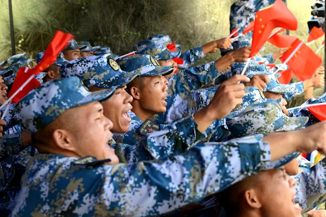 <p>Chinese soldiers cheer in the survival trail event of the International Army Games 2018 'Seaborne Assault' on Aug. 2, 2018 in Quanzhou, Fujian Province of China. (Photo: Wang Dongming/China News Service/VCG via Getty Images) </p>