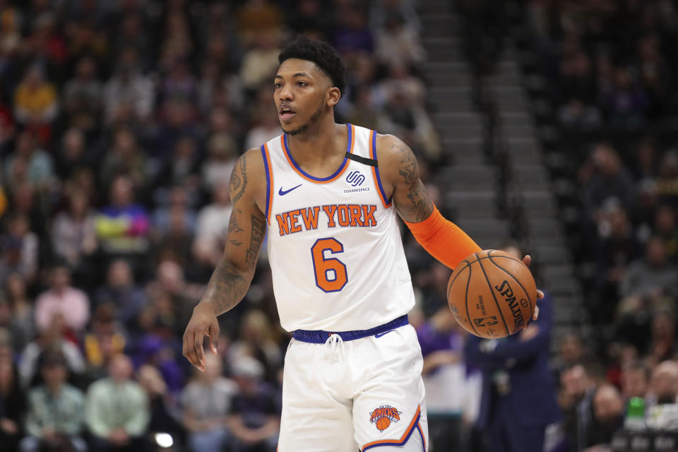 New York Knicks guard Elfrid Payton brings the ball up during the first quarter of the team's NBA basketball game against the Utah Jazz on Wednesday, Jan. 8, 2020, in Salt Lake City. (AP Photo/Chris Nicoll)