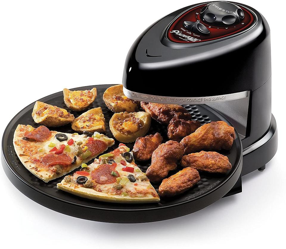 """Greatfor reheating last night's leftover slices if you're not a cold pizza kinda person.<br /><br /><strong>Promising Review:</strong>""""I bought this to cook 'take and bake' pizza in motel rooms. I first started it up and made toast, another difficult thing to do on the road. It worked great! My wife and I make pizza from scratch about once a week and we eat the leftovers for lunch during the week. This turned out to be the best pizza warming device we have ever tried. It now has a home on the counter and is used several times a week."""" —<a href=""""https://www.amazon.com/gp/customer-reviews/RQDXLGHPP1CN?&linkCode=ll2&tag=huffpost-bfsyndication-20&linkId=ef9f943d9647263e04021175632416c7&language=en_US&ref_=as_li_ss_tl"""" target=""""_blank"""" rel=""""noopener noreferrer"""">dstabq</a><br /><br /><strong>Get it from Amazon for <a href=""""https://www.amazon.com/Presto-03430-Pizzazz-Plus-Rotating/dp/B00005IBXJ?&linkCode=ll1&tag=huffpost-bfsyndication-20&linkId=2407b939e5d57437336266f139a13213&language=en_US&ref_=as_li_ss_tl"""" target=""""_blank"""" rel=""""noopener noreferrer"""">$53.89</a>.</strong>"""