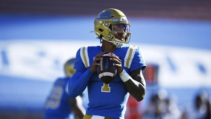 UCLA quarterback Dorian Thompson-Robinson looks to pass during the first half of an NCAA college football game against California in Los Angeles, Sunday, Nov. 15, 2020. (AP Photo/Kelvin Kuo)