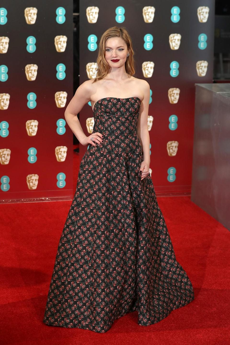 <p>The young actress was striking in a rose-printed Ulyana Sergeenko gown and deep berry lip. <i>[Photo: Getty]</i> </p>