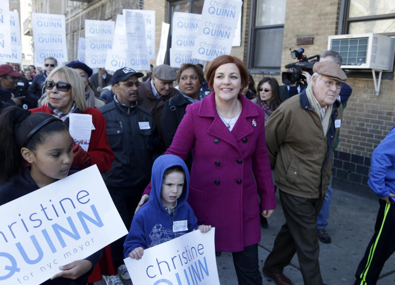 """New York City Council speaker and mayoral hopeful Christine Quinn, center, walks with friends and family during a """"walk and talk"""" tour as part of her announcement to run for mayor in New York, Sunday, March 10, 2013. The New York City Council speaker has formally launched what she hopes will be a history-making mayoral bid this fall. (AP Photo/Seth Wenig)"""