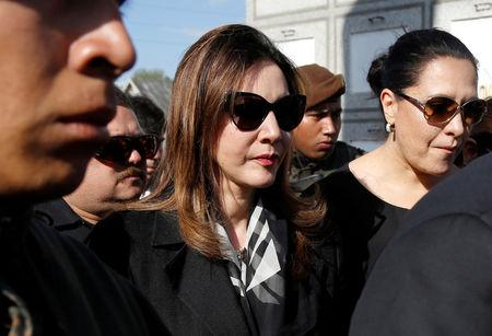 Zury Rios, daughter of former military Guatemalan military dictator Efrain Rios Montt, arrives during his funeral at a cemetery, in Guatemala City, Guatemala