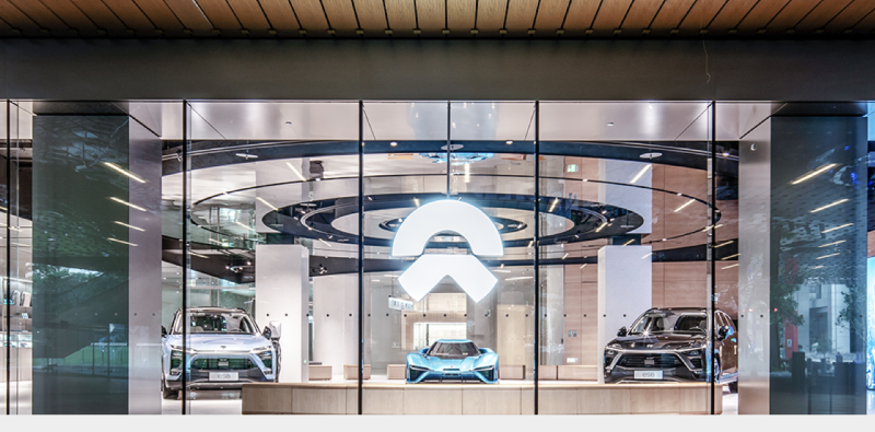 A view of a showcase featuring NIO's electric vehicles.