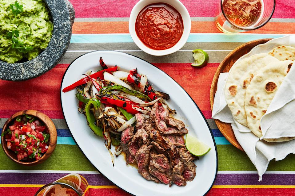 """The mezcal and fish sauce in these fajitas make for a surprisingly good combination. You'll get a smoky, earthy flavor from the mezcal, while the fish sauce adds a little funk and saltiness. If you prefer, use any kind of chopped up chicken or pork in place of the skirt steak. <a href=""""https://www.bonappetit.com/recipe/mezcal-marinated-fajitas?mbid=synd_yahoo_rss"""" rel=""""nofollow noopener"""" target=""""_blank"""" data-ylk=""""slk:See recipe."""" class=""""link rapid-noclick-resp"""">See recipe.</a>"""