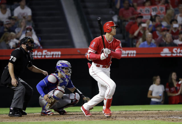 Los Angeles Angels' Shohei Ohtani follows through on a double against the Texas Rangers during the fourth inning of a baseball game Monday, Sept. 10, 2018, in Anaheim, Calif. (AP Photo/Marcio Jose Sanchez)