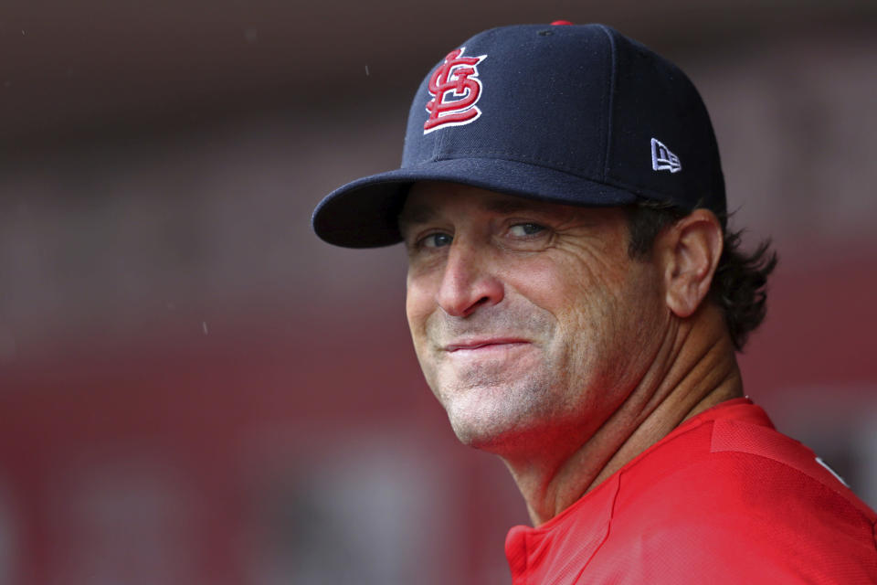 FILE - In this April 14, 2018, file photo, St. Louis Cardinals' manager Mike Matheny stands in the dugout during the first inning of a baseball game against the Cincinnati Reds in Cincinnati. The Kansas City Royals have hired Matheny as manager on Thursday, Oct. 31, 2019. The 49-year-old Matheny was manager of the cross-state Cardinals from 2012-18, going 591-474 and becoming the first manager to reach the postseason his first four seasons. (AP Photo/Aaron Doster, File)