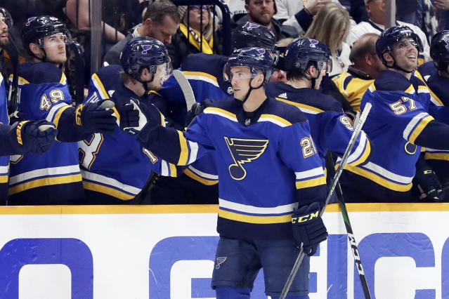 St. Louis Blues center Tyler Bozak (21) is congratulated after scoring a goal against the Nashville Predators in the second period of an NHL hockey game Sunday, Feb. 16, 2020, in Nashville, Tenn. (AP Photo/Mark Humphrey)