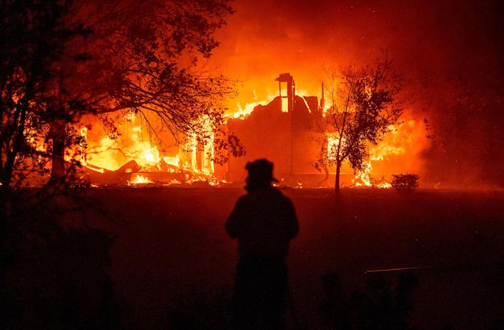 A home burns in Vacaville, CA during the LNU Lightning Complex fire on August 19