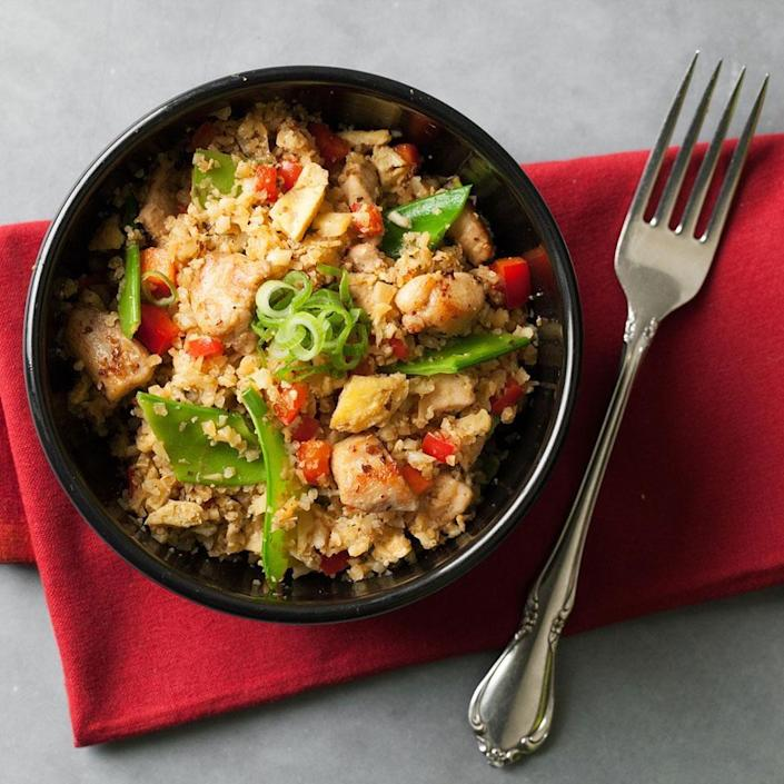 """<p>Get an extra serving of vegetables and cut back on carbs by replacing rice with riced cauliflower in this healthy chicken fried rice recipe. <a href=""""https://www.eatingwell.com/recipe/254623/cauliflower-chicken-fried-rice/"""" rel=""""nofollow noopener"""" target=""""_blank"""" data-ylk=""""slk:View Recipe"""" class=""""link rapid-noclick-resp"""">View Recipe</a></p>"""