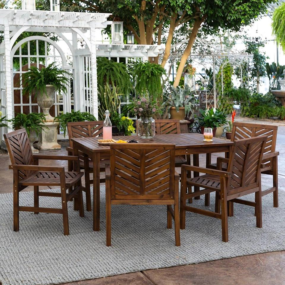 <p>You'll never have to worry about the acacia wood frame on the <span>Chevron Outdoor Patio Dining Set</span> ($1,099) - it's weather-resistant.</p>