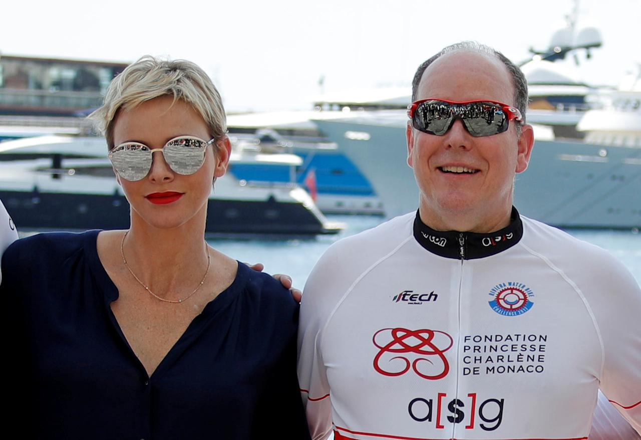 Prince Albert II of Monaco (R) and his wife Princess Charlene pose after the arrival of the Riviera Water Bike Challenge in support of the Princess Charlene of Monaco Foundation, in Nice, France, June 4, 2017.      REUTERS/Eric Gaillard