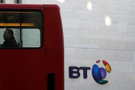 FILE PHOTO: A bus passes a BT logo outside of offices in the City of London, Britain, January 24, 2017. REUTERS/Toby Melville/File Photo