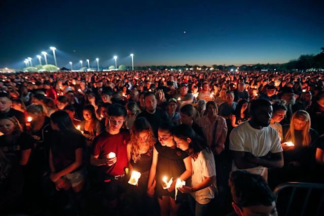 <p>People attend a candlelight vigil for the victims of the Wednesday shooting at Marjory Stoneman Douglas High School, in Parkland, Fla., Thursday, Feb. 15, 2018. (Photo: Gerald Herbert/AP) </p>