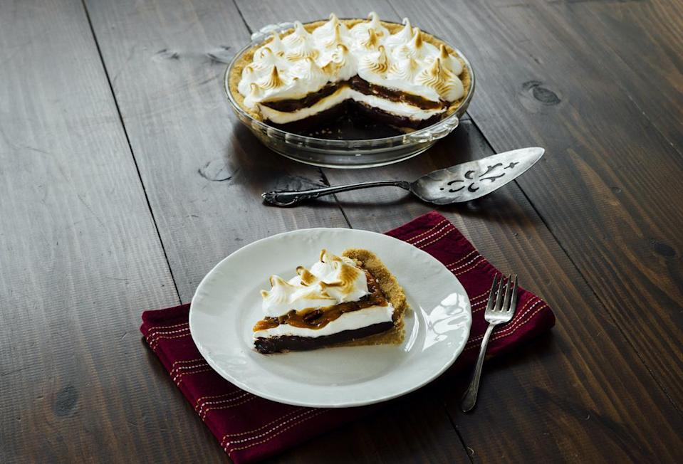 """<p>If one of your <a href=""""https://www.thedailymeal.com/cook/nostalgic-childhood-desserts?referrer=yahoo&category=beauty_food&include_utm=1&utm_medium=referral&utm_source=yahoo&utm_campaign=feed"""" rel=""""nofollow noopener"""" target=""""_blank"""" data-ylk=""""slk:favorite childhood treats"""" class=""""link rapid-noclick-resp"""">favorite childhood treats</a> was a Moon Pie, then this recipe will be your next go-to when you bake. The chocolate cream pie is topped with a caramel praline sauce and marshmallow meringue.</p> <p><a href=""""https://www.thedailymeal.com/recipes/chocolate-cream-pie-praline-sauce-recipe?referrer=yahoo&category=beauty_food&include_utm=1&utm_medium=referral&utm_source=yahoo&utm_campaign=feed"""" rel=""""nofollow noopener"""" target=""""_blank"""" data-ylk=""""slk:For the Chocolate Cream Pie with Praline Sauce recipe, click here."""" class=""""link rapid-noclick-resp"""">For the Chocolate Cream Pie with Praline Sauce recipe, click here.</a></p>"""