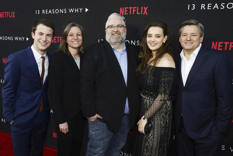 Dylan Minnette, Netflix VP, Original Content Cindy Holland, Exec. Producer Brian Yorkey, Katherine Langford and Netflix Chief Content Officer Ted Sarandos seen at Netflix '13 Reasons Why' Premiere at Paramount Studios on Thursday, March 30, 2017, in Los Angeles, CA. (Photo by Steve Cohn/Invision for Netflix/AP Images)