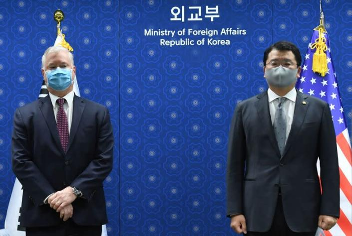U.S. Deputy Secretary of State Stephen Biegun and South Korean Vice Foreign Minister Choi Jong-kun pose for photographs during their meeting at the Foreign Ministry in Seoul
