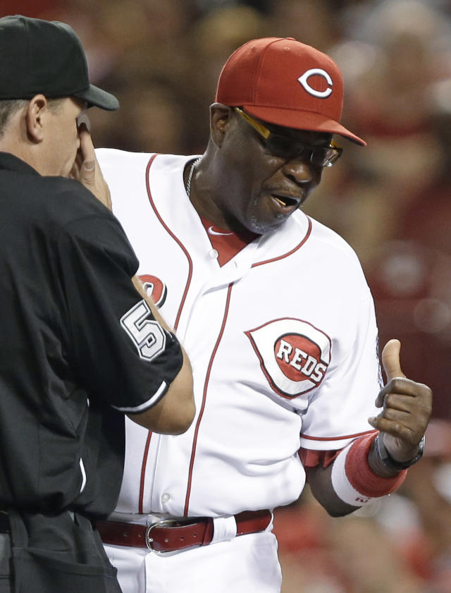 Cincinnati Reds manager Dusty Baker argues a call at home plate with umpire Paul Emmel in the fourth inning of a baseball game against the Chicago Cubs, Tuesday, Sept. 10, 2013, in Cincinnati. Chicago Cubs' Edwin Jackson had just scored on a sacrifice fly by Darwin Barney. (AP Photo/Al Behrman)