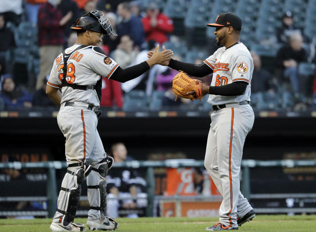 Baltimore Orioles relief pitcher Mychal Givens, right, celebrates with catcher Pedro Severino after the Orioles defeated the Chicago White Sox 5-4 in the first game of a baseball doubleheader in Chicago, Wednesday, May 1, 2019. (AP Photo/Nam Y. Huh)