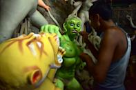 ASSAM,INDIA-OCTOBER 9,2020:An artist finishing Asura where Durga idols are being prepared ahead of the biggest Hindu festival Durga puja in Nagaon District of Assam ,india - PHOTOGRAPH BY Anuwar Ali Hazarika / Barcroft Studios / Future Publishing (Photo credit should read Anuwar Ali Hazarika/Barcroft Media via Getty Images)