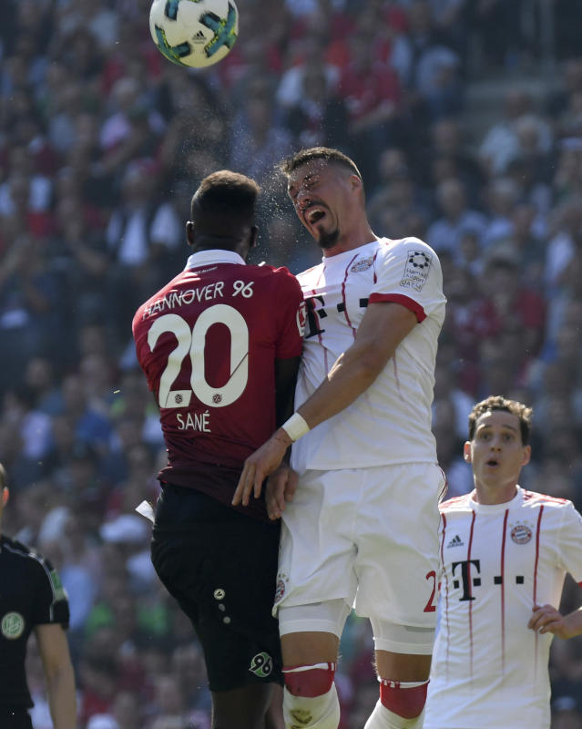 Hannover's Salif Sane, left, amd Munich's Sandro Wagner challenge for the ball during a German Bundesliga soccer match between Hannover 96 and Bayern Munich in Hannover, Germany, Saturday, April 21, 2018. (Peter Steffen/dpa via AP)