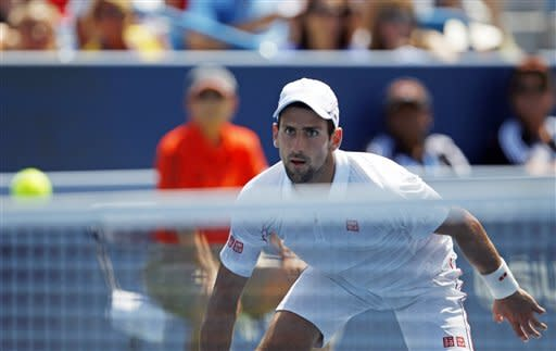 Novak Djokovic, from Serbia, eyes the ball during a match against Andreas Seppi, from Italy, at the Western & Southern Open tennis tournament, Wednesday, Aug. 15, 2012, in Mason, Ohio. (AP Photo/Frank Victores)