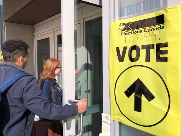 Students visit an advance polling station set up on a university campus in Toronto, which won't be available this election. (Alvin Yu/CBC - image credit)