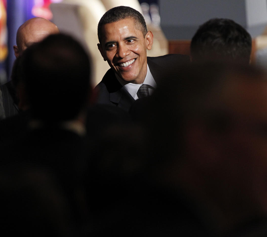 President Barack Obama greets supporters during a fundraiser at the Palmer House Hotel in Chicago, Friday, March, 16, 2012. (AP Photo/Pablo Martinez Monsivais)