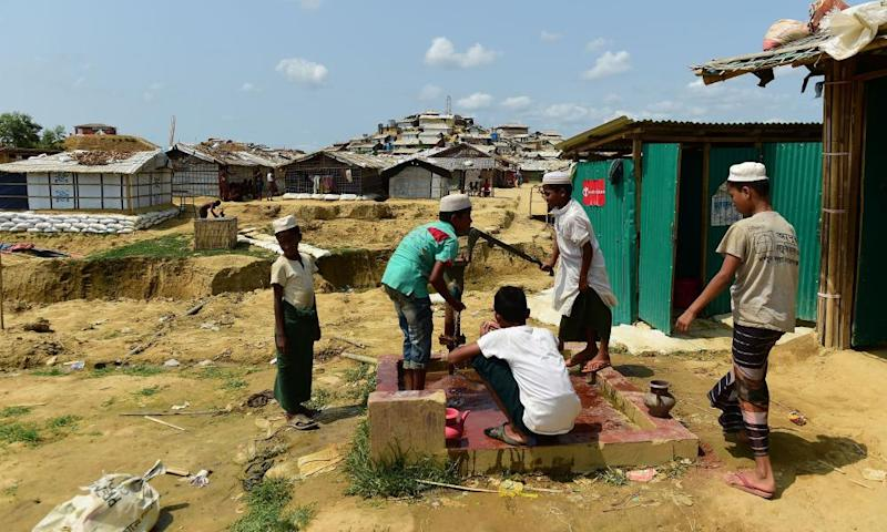Rohingya men preparing to make an offering for afternoon prayers at the Cox's Bazaar refugee camp.