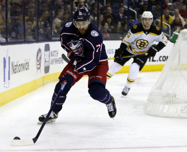 """FILE - In this March 12, 2019, file photo, Columbus Blue Jackets forward Nick Foligno, left, controls the puck in front of Boston Bruins defenseman Brandon Carlo during an NHL hockey game in Columbus, Ohio. """"Maybe we dont have the shiny pieces people like to talk about,"""" Foligno said. """"But theres going to be a lot of headlines, a lot of great plays going on because of the skill we have."""" The Blue Jackets open training camp this week. (AP Photo/Paul Vernon, File)"""