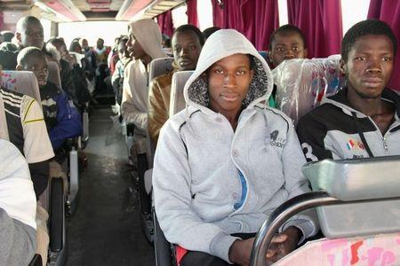 A group of Senegalese illegal immigrants, who according to authorities will be deported back to Senegal through the border with Tunisia, sit in a bus at the Alkarareem immigration centre in the east of Misrata February 26, 2015. REUTERS/Stringer