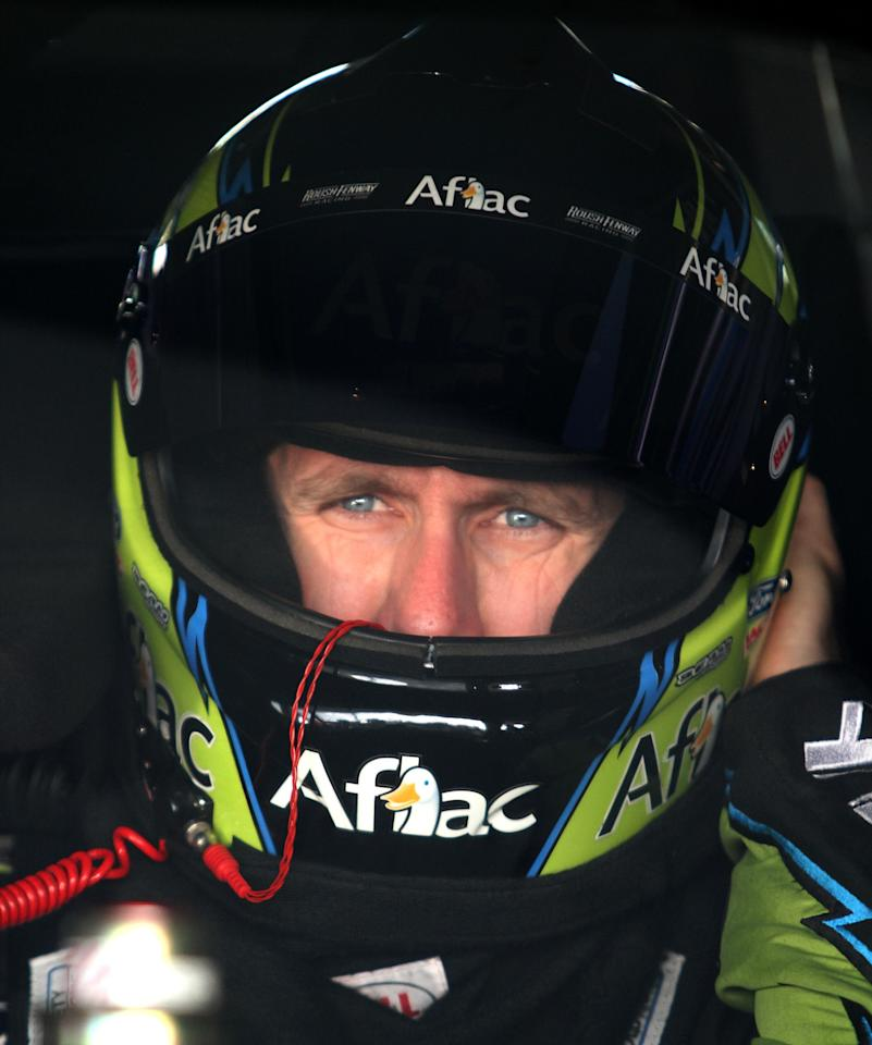 HOMESTEAD, FL - NOVEMBER 19:  Carl Edwards, driver of the #99 Aflac Ford, sits in his car during practice for the NASCAR Sprint Cup Series Ford 400 at Homestead-Miami Speedway on November 19, 2011 in Homestead, Florida.  (Photo by Jerry Markland/Getty Images for NASCAR)