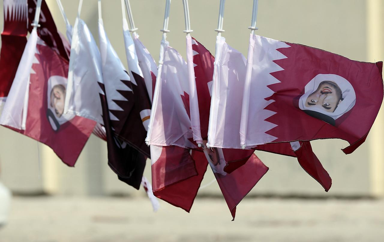 DOHA, QATAR - JANUARY 07:  Flag and scarves of Qatar are seen after the FC Bayern Muenchen training session at Aspire Academy for Sports Excellence training ground on January 7, 2011 in Doha, Qatar.  (Photo by Christof Koepsel/Bongarts/Getty Images)