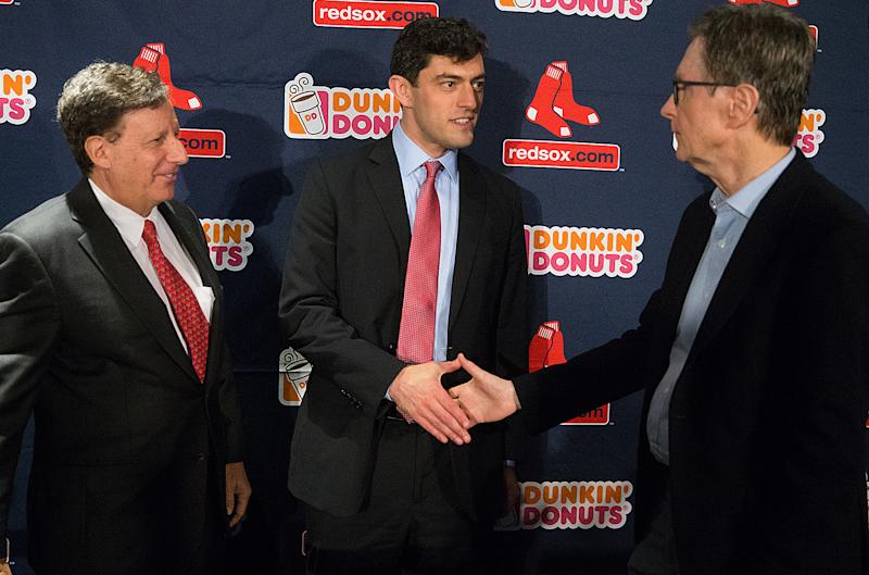 BOSTON, MA. - OCTOBER 28: Chaim Bloom, new Red Sox Chief Baseball Officer shakes hands with John Henry as Tom Werner looks on after a press conference at Fenway Park on October 28, 2019 in Boston, Massachusetts.